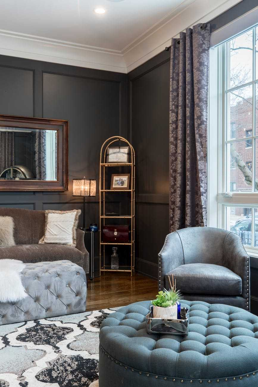 vacant gray leather tub chair in room