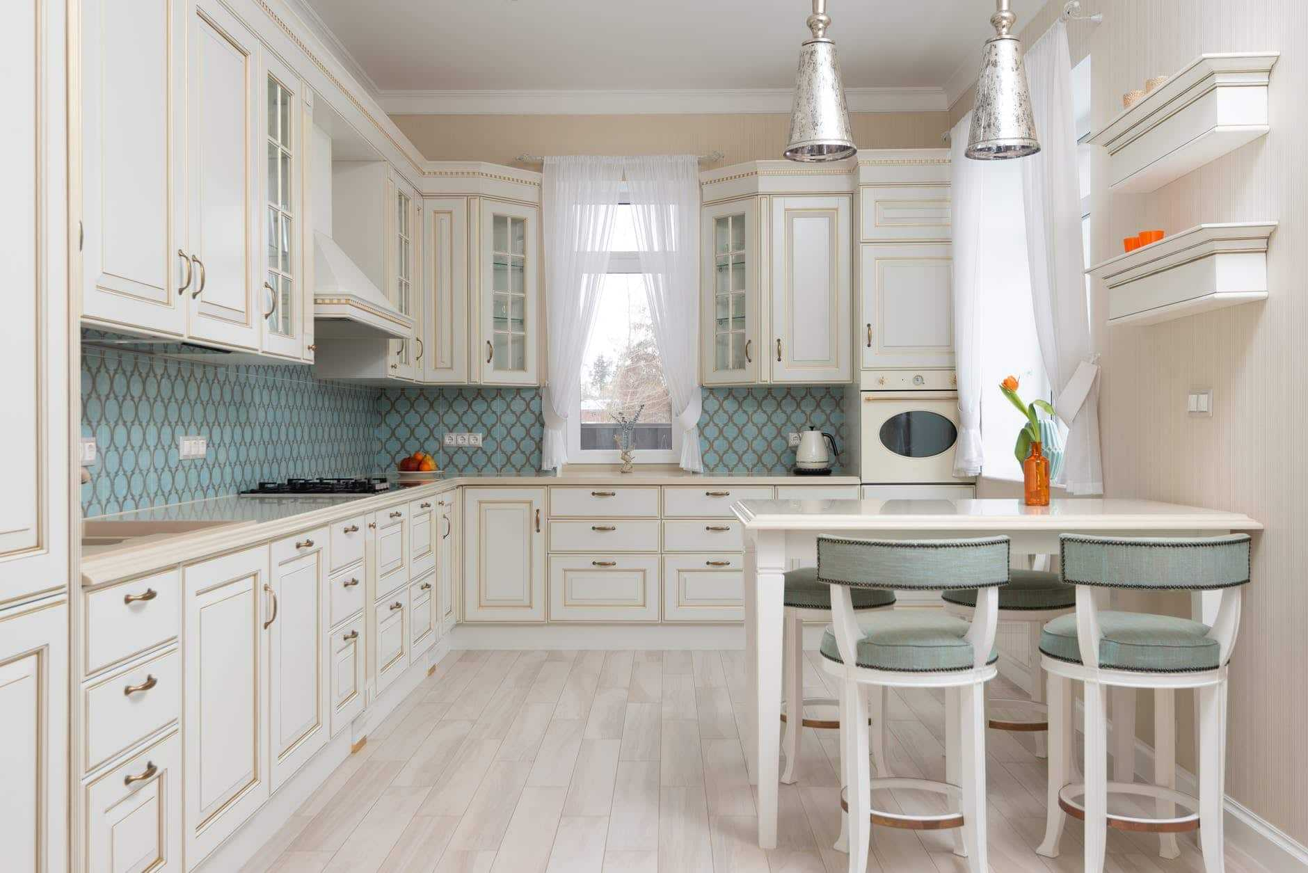 kitchen with cabinets and table with chairs